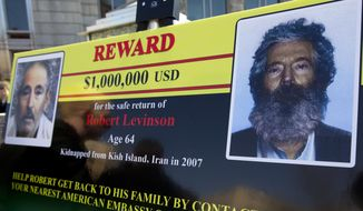 In this March 6, 2012, file photo, an FBI poster showing a composite image of former FBI agent Robert Levinson, right, of how he would look like now, left, taken from the video, released by his captors in Washington during a news conference. The family of Levinson is holding a rally Saturday, March 5, 2016, demanding that the U.S. government keep pushing for his freedom.  (AP Photo/Manuel Balce Ceneta)