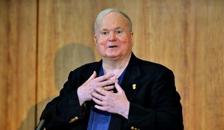 In this May 16, 2014, file photo, author Pat Conroy speaks to a crowd during a ceremony at the Hollings Library in Columbia, S.C. Conroy, whose best-selling novels drew from his own sometimes painful experiences and evoked vistas of the South Carolina coast and its people, has died at age 70. (AP Photo/ Richard Shiro, File)