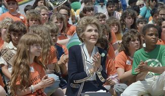 """First lady Nancy Reagan joins school children during an anti-drug """"Just Say No"""" rally on the grounds of the Washington Monument on May 12, 1988. (Associated Press)"""