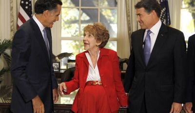 Republican presidential candidates former Massachusetts Gov. Mitt Romney, left, and Texas Gov. Rick Perry, right, meet with former first lady Nancy Reagan before a Republican presidential candidate debate at the Reagan Library Wednesday, Sept. 7, 2011, in Simi Valley, Calif.  (AP Photo/Chris Carlson, Pool)