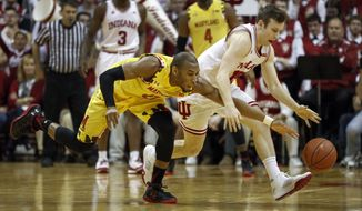Maryland guard Rasheed Sulaimon, left, goes after a loose ball with Indiana guard Harrison Niego in the first half of an NCAA college basketball game in Bloomington, Ind., Sunday, March 6, 2016. (AP Photo/AJ Mast)