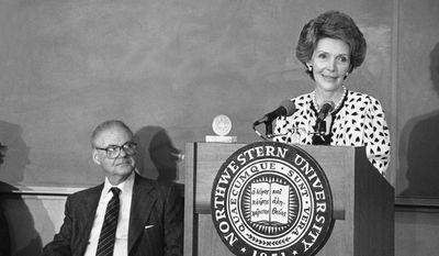 First lady Nancy Regan accepts a medallion on behalf of her father, Dr. Loyal Davis, at Northwestern University Medical School in Chicago on Friday, May 15, 1982. The ceremony commemorated the establishment of a chair of surgery at Northwestern in honor of Dr. Davis, and his wife Edith. Dr. Davis was chairman of surgery there for 31 years, from 1932-63. (AP Photo/Fred Jewell)