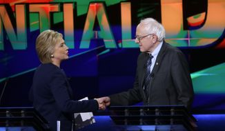 Democratic presidential candidates, Hillary Clinton and Sen. Bernie Sanders, I-Vt., right, shake hands at the end of a Democratic presidential primary debate at the University of Michigan-Flint, Sunday, March 6, 2016, in Flint, Mich. (AP Photo/Carlos Osorio) ** FILE **