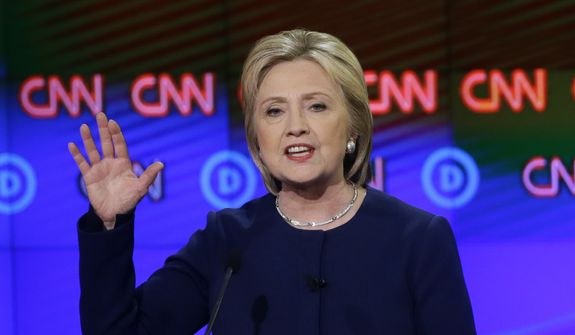 Democratic presidential candidate, Hillary Clinton makes a point during a Democratic presidential primary debate at the University of Michigan-Flint, Sunday, March 6, 2016, in Flint, Mich. (AP Photo/Carlos Osorio)