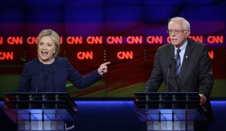 Hillary Clinton argues a point as Sen. Bernard Sanders listens during the Democratic debate Sunday night in Flint, Mich. (Associated Press) **FILE**