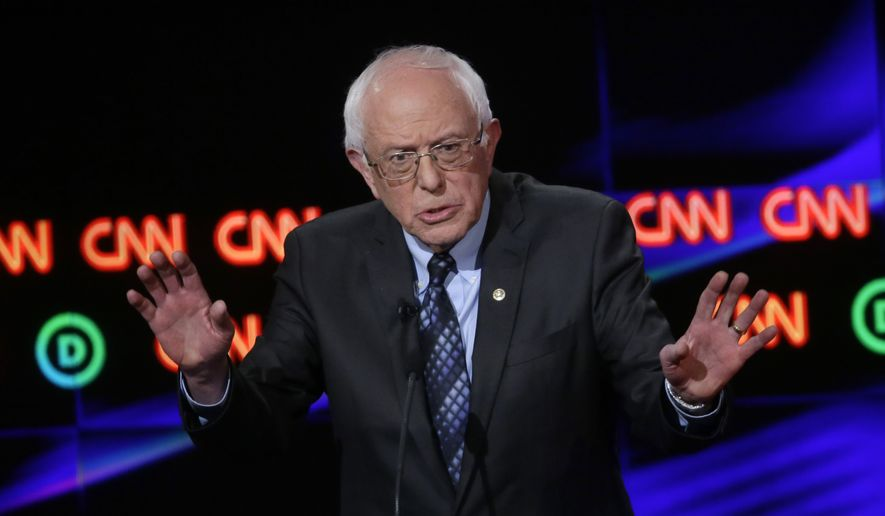 Democratic presidential candidate, Sen. Bernie Sanders, I-Vt., argues a point during a Democratic presidential primary debate at the University of Michigan-Flint, Sunday, March 6, 2016, in Flint, Mich. (AP Photo/Carlos Osorio)