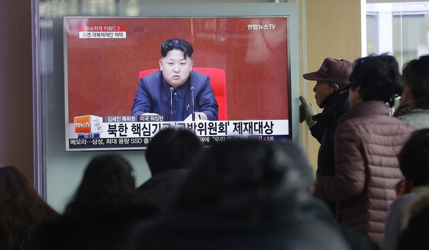 People watch a TV news program showing North Korean leader Kim Jong-un at Seoul Railway Station on March 3. (Associated Press)
