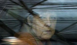 German Chancellor Angela Merkel looks out of her car window as she arrives for an EU summit at the EU Council building in Brussels on Monday, March 7, 2016. European Union leaders are holding a summit in Brussels on Monday with Turkey to discuss the current migration crisis. (AP Photo/Virginia Mayo)