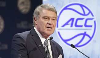 Commissioner John Swofford speaks to the media during the Atlantic Coast Conference men's NCAA basketball media day in Charlotte, N.C., Wednesday, Oct. 28, 2015. (AP Photo/Chuck Burton)