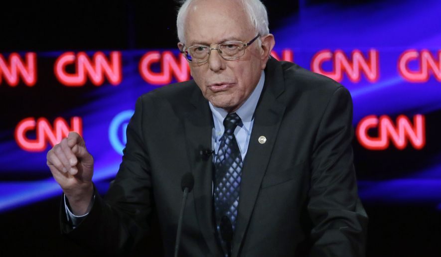 Democratic presidential candidate, Sen. Bernie Sanders, I-Vt., makes a point during a Democratic presidential primary debate at the University of Michigan-Flint, Sunday, March 6, 2016, in Flint, Mich. (AP Photo/Carlos Osorio)