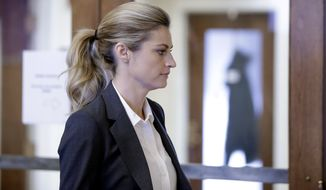 Sportscaster and television host Erin Andrews walks to the courtroom Monday in Nashville, Tenn. (Associated Press)