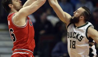 Chicago Bulls center Pau Gasol, left, shoots against Milwaukee Bucks center Miles Plumlee during the first half of an NBA basketball game Monday, March 7, 2016, in Chicago. (AP Photo/Nam Y. Huh)