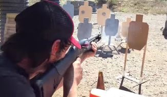 """John Wick"" star Keanu Reeves showed off his real-life shooting skills on a 3-gun training course in a new video released by a California gun range. (YouTube/@Taran Tactical)"