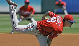 Philadelphia Phillies pitcher Vincent Velasquez follows through on a delivery to the Pittsburgh Pirates during the first inning of a spring training baseball game Monday, March 7, 2016, in Tampa, Fla. (AP Photo/Chris O'Meara)