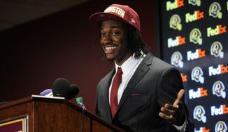 Washington Redskins first round NFL football draft pick, Robert Griffin III, speaks at a press conference, Saturday, April 28, 2012, in Landover, Md. (AP Photo/Nick Wass)