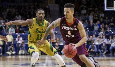 Virginia Tech's Seth Allen (4) drives by Notre Dame's Demetrius Jackson (11) during the second half of Notre Dame's 83-81 win over Virginia Tech in an NCAA college basketball game Wednesday, Jan. 20, 2016, in South Bend, Ind.  (AP Photo/Robert Franklin)