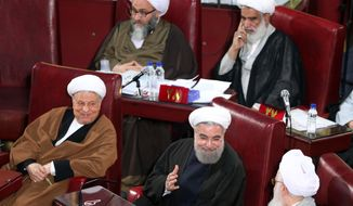 CORRECTS DAY TO TUESDAY - Iranian President Hassan Rouhani, bottom center, who is also a member of the Assembly of Experts, attends the last seasonal meeting of the fourth assembly in Tehran, Iran, Tuesday, March 8, 2016. The next Assembly of Experts meeting will be held on late May by the new Experts who have won the recent elections. (AP Photo/Ebrahim Noroozi)