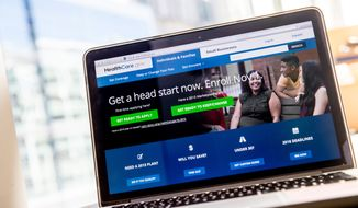 The HealthCare.gov website, where people can buy health insurance, is displayed on a laptop screen. (Associated Press) ** FILE **