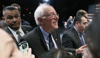 Democratic presidential candidate, Sen. Bernie Sanders, I-Vt. greets supporters after speaking at a campaign rally, Monday, March 7, 2016, in Dearborn, Mich. (AP Photo/Charlie Neibergall)