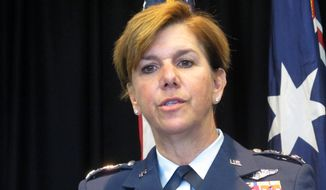 Gen. Lori Robinson, the commander of the Pacific Air Forces, talks to reporters Tuesday, March 8, 2016, at the U.S. Embassy in Canberra, Australia. She said the U.S. Air Force will continue to fly daily missions over the South China Sea despite a buildup of Chinese surface-to-air missiles and fighter jets in the contested region. (AP Photo/Rod McGuirk)