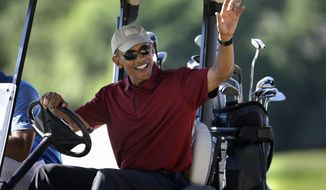 """FILE - In this Aug. 14, 2015, file photo, President Barack Obama waves from a golf cart while golfing at Farm Neck Golf Club, in Oak Bluffs, Mass., on the island of Martha's Vineyard. Obama's doctor says the president's health remains excellent overall and that he has even improved from his last physical by lowering his cholesterol level and gaining muscle. Dr. Ronny Jackson, the president's physician, says the """"president continues to focus on healthy lifestyle choices."""" (AP Photo/Steven Senne, File)"""