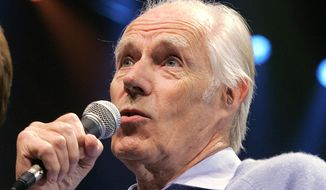 "Beatles producer Sir George Martin answers a question from the media after the sneak preview of a new Beatles-themed Cirque du Soleil show, ""Love,"" in Las Vegas, in this Wednesday, May 24, 2006, file photo. (AP Photo/Jae C. Hong, File)"