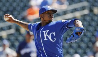 Kansas City Royals' Yordano Ventura throws a pitch against the Milwaukee Brewers during the first inning of a spring training baseball game Wednesday, March 9, 2016, in Surprise, Ariz. (AP Photo/Ross D. Franklin)
