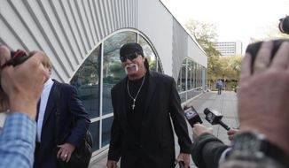 Hulk Hogan, whose given name is Terry Bollea, arrives at court Tuesday, March 8, 2016, in his case against the news website Gawker at the Pinellas County Courthouse, in St. Petersburg, Fla. (John Pendygraft/Tampa Bay Times via AP)