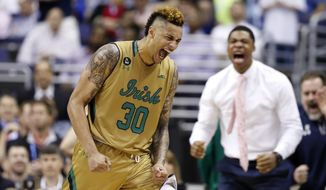 Notre Dame forward Zach Auguste (30) reacts after a play during the second half of an NCAA college basketball game in the Atlantic Coast Conference tournament against Duke, Thursday, March 10, 2016, in Washington. Notre Dame won 84-79 in overtime. (AP Photo/Alex Brandon)
