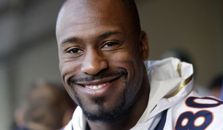 Denver Broncos tight end Vernon Davis smiles as he speaks to reporters in Santa Clara, Calif., Wednesday, Feb. 3, 2016. The Denver Broncos will play the Carolina Panthers in Super Bowl 50 Sunday, Feb. 7, 2016. (AP Photo/Jeff Chiu)