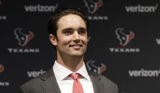 Houston Texans quarterback Brock Osweiler holds his new jersey as he is introduced during a news conference Thursday, March 10, 2016, in Houston. The Texans have filled their biggest need, starting free agency with a splash by snagging Osweiler from Denver. (AP Photo/David J. Phillip)