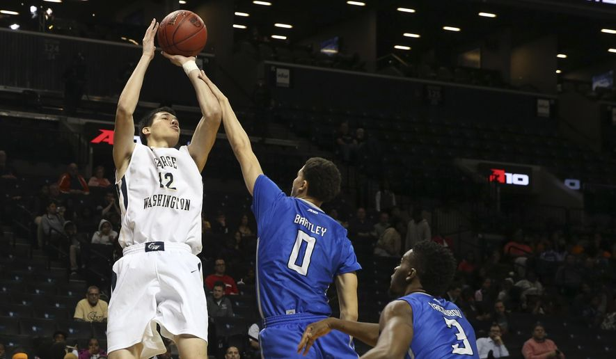 George Washington forward Yuta Watanabe (12) shoots past Saint Louis guard Marcus Bartley (0) and guard Ash Yacoubou (3) during the first half of an NCAA college basketball game in the Atlantic 10 men's tournament, Thursday, March 10, 2016, in New York. (AP Photo/Mary Altaffer) **FILE**