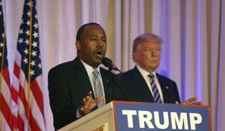 Former Republican presidential candidate Ben Carson, speaks after announcing he will endorse Republican presidential candidate Donald Trump, right, during a news conference at the Mar-A-Lago Club, Friday, March 11, 2016, in Palm Beach, Fla. (AP Photo/Lynne Sladky)