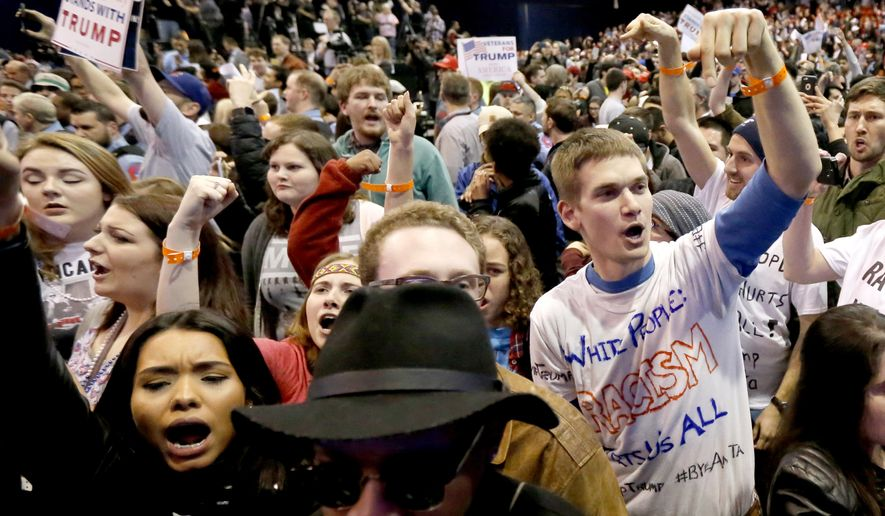 Protesters of Republican presidential candidate Donald Trump, right, chant after a rally on the campus of the University of Illinois-Chicago, was canceled due to security concerns Friday, March 11, 2016, in Chicago. (AP Photo/Charles Rex Arbogast)