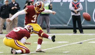 Washington Redskins kicker Dustin Hopkins (3), with Tress Way holding, kicks a field goal against the New York Jets during the first half of an NFL football game, Sunday, Oct. 18, 2015, in East Rutherford, N.J. (AP Photo/Gary Hershorn)