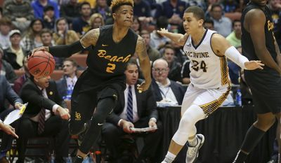 Long Beach State guard Nick Faust drives the base line against UC Irvine's Dominque Dunning during the first half of an NCAA college basketball game at the Big West conference men's tournament Friday, March 11, 2016, in Anaheim, Calif. (AP Photo/Lenny Ignelzi)