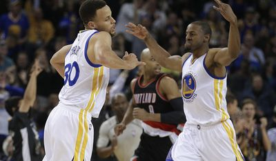 Golden State Warriors' Stephen Curry, left, and Andre Iguodala celebrate a score against the Portland Trail Blazers during the first half of an NBA basketball game Friday, March 11, 2016, in Oakland, Calif. (AP Photo/Ben Margot)