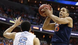 Virginia guard Malcolm Brogdon (15) shoots against North Carolina guard Marcus Paige (5) during the first half of an NCAA college basketball game in the championship of the Atlantic Coast Conference tournament, Saturday, March 12, 2016, in Washington. (AP Photo/Alex Brandon)