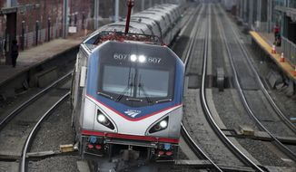 An Amtrak train passes through Elizabeth train station Saturday, March 12, 2016, in Elizabeth, N.J., along Amtrak's Northeast Corridor. (AP Photo/Mel Evans) ** FILE **