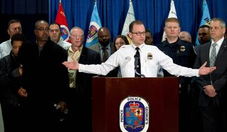 """Prince George's County Police Chief Hank Stawinski called Officer Jacai Colson """"a hero,"""" saying he fired at Michael Ford, momentarily drawing the shooter's attention away from the station and affording officers a chance to take cover. No other officers were injured. (Associated Press)"""