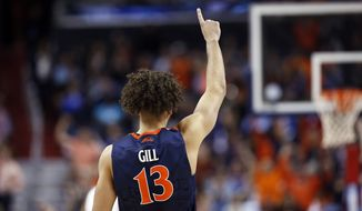 Virginia forward Anthony Gill (13) signals to teammates during the second half of an NCAA college basketball game in the championship of the Atlantic Coast Conference tournament against North Carolina, Saturday, March 12, 2016, in Washington. (AP Photo/Alex Brandon)