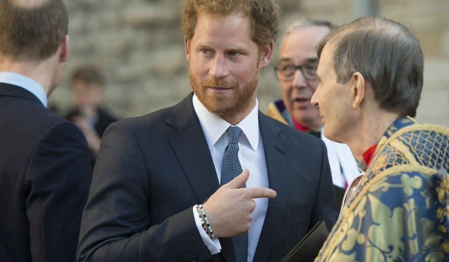 Britain's Prince Harry gestures after attending the Commonwealth Day service at Westminster Abbey in London, Monday, March 14, 2016. Organised by the Royal Commonwealth Society, the service is the largest annual inter-faith gathering in the United Kingdom. (Geoff Pugh, Pool Photo via AP)
