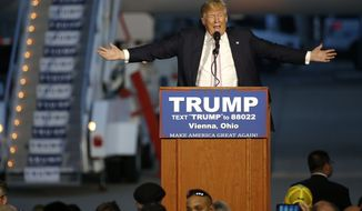 Republican presidential candidate, Donald Trump holds a plane-side rally at Youngstown-Warren Regional Airport in Vienna, Ohio, Monday, March 14, 2016.  (AP Photo/Gene J. Puskar)