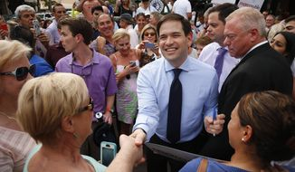 In this March 11, 2016, photo, Republican presidential candidate, Sen. Marco Rubio, R-Fla. greets supporters in Naples, Fla. After a brutal run of results in his campaign for president, Rubio's political future will be decided by voters in his home state of Florida on March 15. Given the change to breathe new life into his White House bid, they may instead deliver a loss staggering enough to push him out of politics. (AP Photo/Paul Sancya)