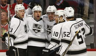 Los Angeles Kings left wing Milan Lucic, second left, celebrates with teammates a goal scored against the Chicago Blackhawks during the first period of an NHL hockey game, Monday, March 14, 2016, in Chicago. (AP Photo/Kamil Krzaczynski)