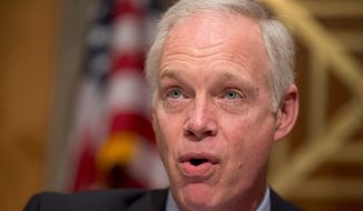 Sen. Ron Johnson said a San Bernardino conspirator was prevented from being confronted by armed agents by immigration authorities. (Associated Press)