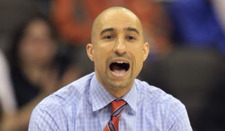 Texas head coach Shaka Smart yells to his team during the first half of an NCAA college basketball game against Baylor in the quarterfinals of the Big 12 conference tournament in Kansas City, Mo., Thursday, March 10, 2016. (AP Photo/Orlin Wagner)
