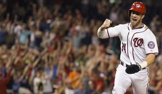 Washington Nationals' Bryce Harper pumps his fist as he scores the winning run on a single by Anthony Rendon during the ninth inning of a baseball game against the Arizona Diamondbacks on Wednesday, Aug. 20, 2014, in Washington. The Nationals defeated the Diamondbacks 3-2. (AP Photo/Evan Vucci)
