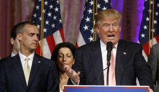 Republican presidential candidate Donald Trump speaks to supporters at his primary election night event at his Mar-a-Lago Club in Palm Beach, Fla., Tuesday, March 15, 2016. At left was his then-campaign manager Corey Lewandowski. (AP Photo/Gerald Herbert) ** FIL E**