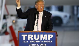 Republican presidential candidate, Donald Trump holds a plane-side rally in a hanger at Youngstown-Warren Regional Airport in Vienna, Ohio, Monday, March 14, 2016.  (AP Photo/Gene J. Puskar)